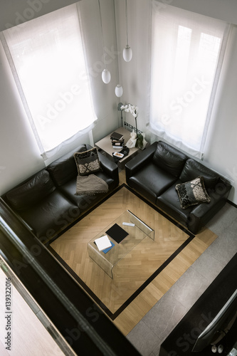 Interior View From Above The Modern Living Room With Black Leather