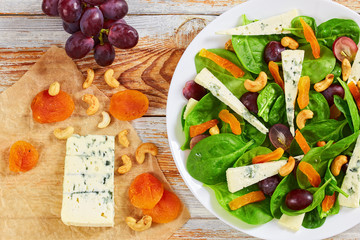 grape, blue cheese, spinach, dried apricots salad