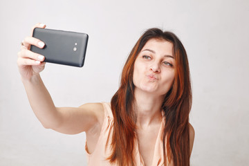 Woman taking selfie
