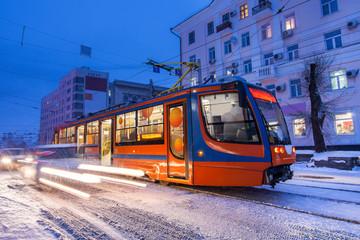 KHABAROVSK, RUSSIA - JANUARY 14, 2017: Tram in the street of winter city of Khabarovsk