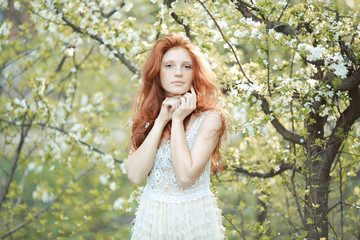 Portrait of redhead girl spring