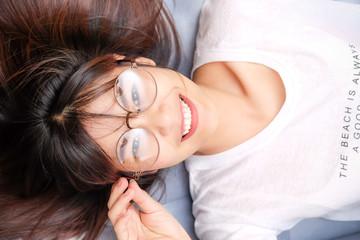 Glasses smile asian women rest on sofa