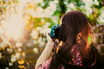 Soft blur portrait photographer takes picture with sun ligth