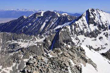 Snow covered alpine landscape in mountainous avalanche terrain on Colorado 14er Little Bear Peak, terrain sensitive to climate change, Sangre de Cristo Range, Rocky Mountains, Colorado USA
