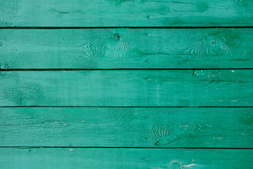 Turquoise old wooden background with cracks