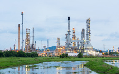Oil refinery plant at sunrise with blue sky background