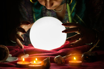 Fortune teller woman looking at crystal ball