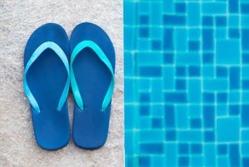 Stripped flip-flop summer shoes on poolside.