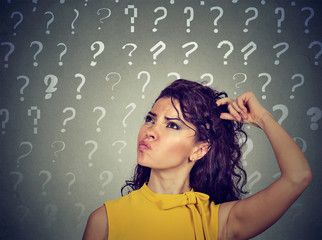 confused thinking woman scratching head has many questions