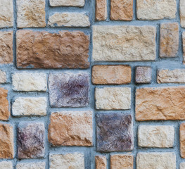 Seamless texture of the wall of rubble stone.