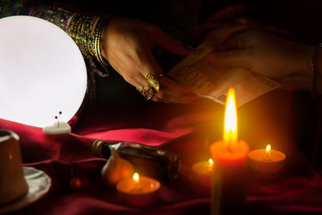 Fortune teller receive money for fortune telling
