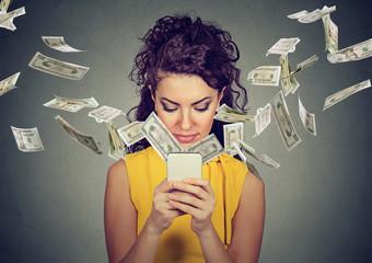 woman using smartphone making money