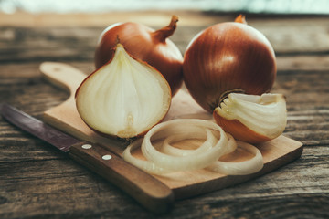 Onion cuts on chopping board