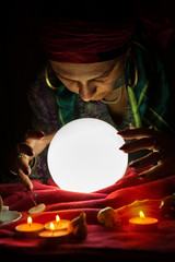 Crystal ball for fortune telling and hands of gypsy fortune teller