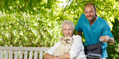 Carer and elderly person with dog
