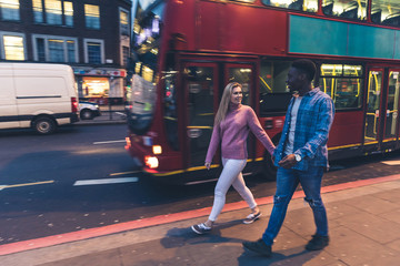 Mixed race couple walking in London at night