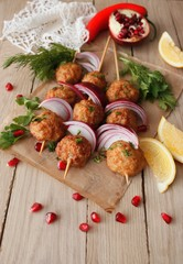 Kofta skewers, meatballs and red onion delicious oriental cuisine, top view