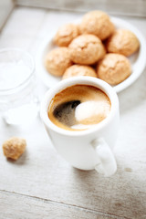 Cup of Coffee, glass of water and biscotti