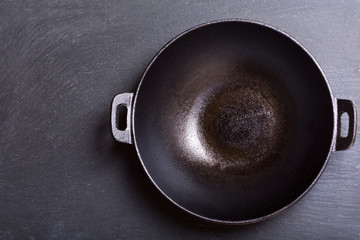 empty wok in a dark background