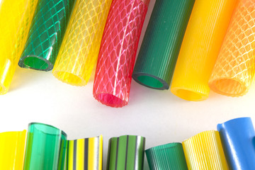 colorful plastic gardening hoses on white background