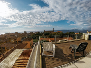 Relaxing terrace view with two seats in Piombino, Tuscany, Italy