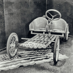 Antique photography of a pedal car without petrol engine.