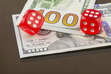 Two red dice poker on banknotes