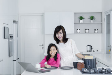 Mother and daughter breakfast in the kitchen