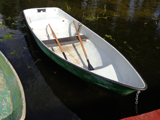 The anchored boat at the pier