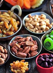 Healthy food - raisins, dried cranberries, kiwi, apricots, papaya, pistachios, cashews, almonds and more.