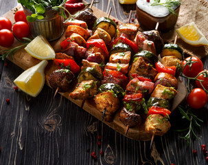 Grilled skewers with vegetables and meat in a herb marinade on a dark wooden table