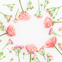 Round frame with pink roses isolated on white background. Flat lay, top view