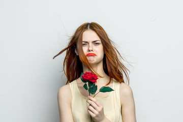 frustrated woman with a flower in her hand