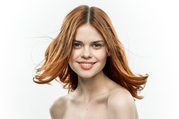 happy woman with red hair on a light background