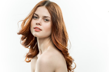 attractive red-haired woman on a light background