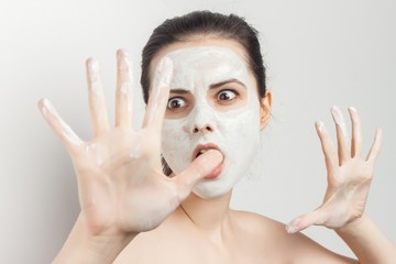 angry woman shows smeared hands