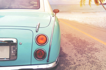 Fototapete - Journey of beach holiday - Rear of classic car parked side beach in summer. vintage retro color effect styles