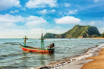 Fishing boat at beach on summer season
