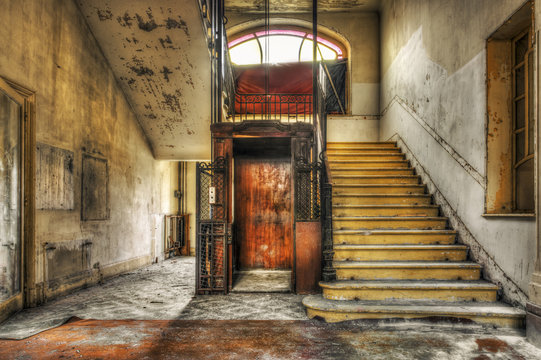 Old vintage lift at abandoned hotel lobby