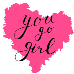 The inscription: You go girl. Hand drawn lettering on heart background.