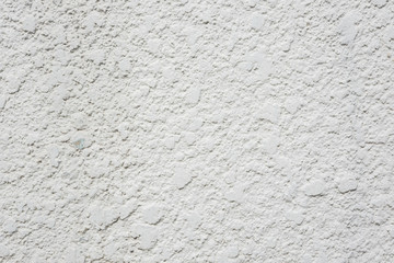 Rough white concrete wall background, texture