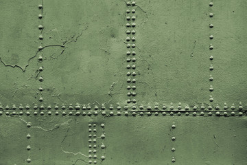 Old military green metal sheets with rivet