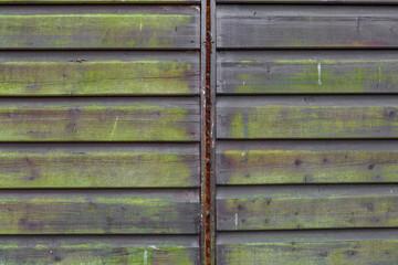 Hintergrund stark verwitterte Holzwand