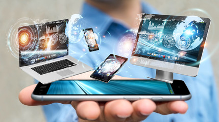 Businessman connecting tech devices with his mobile phone 3D rendering