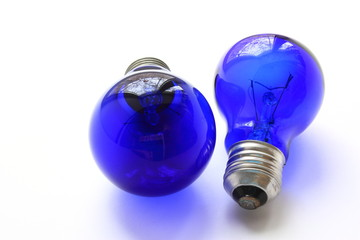 Filament lamp with blue glass. Two lamps, one more, one less.