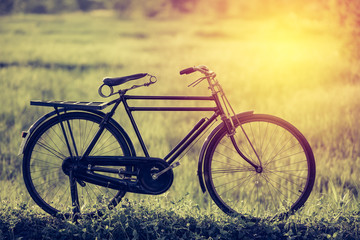 beautiful landscape image with vintage bicycle;vintage tone style