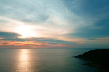 Beautiful Tropical Sunset Scene in the Sea. Phuket Lam Phromthep. Sun and Cloud Background.