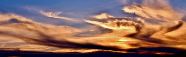 Incredible colors of ominous clouds in the desert sky at sunset in southern Arizona.