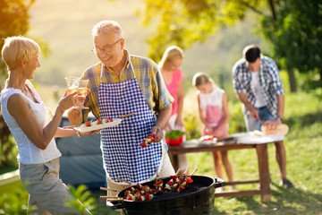 Happy family having a barbecue party.