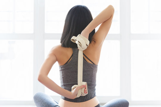 Fitness young woman doing yoga exercise in sportswear